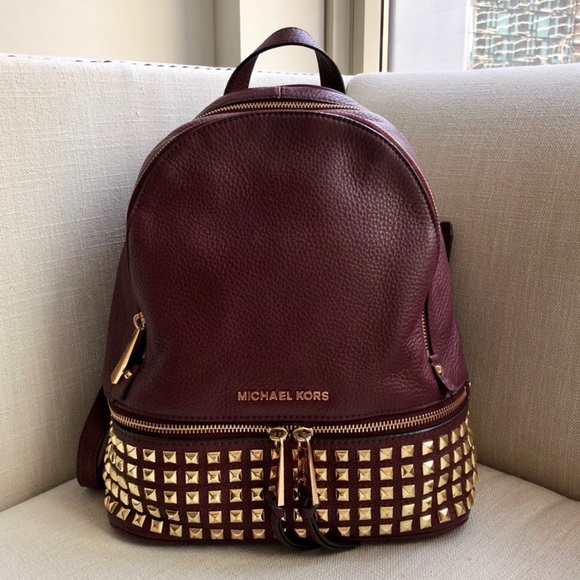 120fcd1d9d4a Michael Kors Rhea Medium Studded Backpack. M_5c35d545035cf19a71f97046
